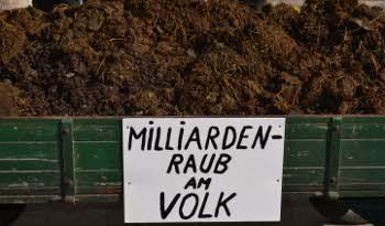 Protestplakat zum Thema Agrargemeinschaften